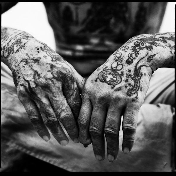 Tattoo details on a monk's hands
