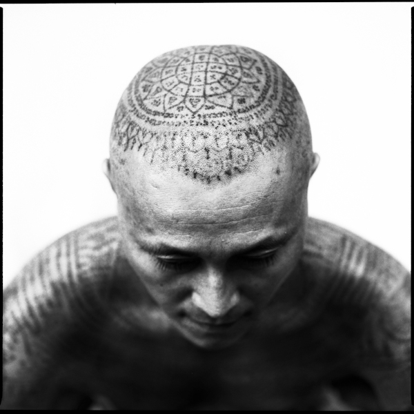 Tattoo details on top of a man's head