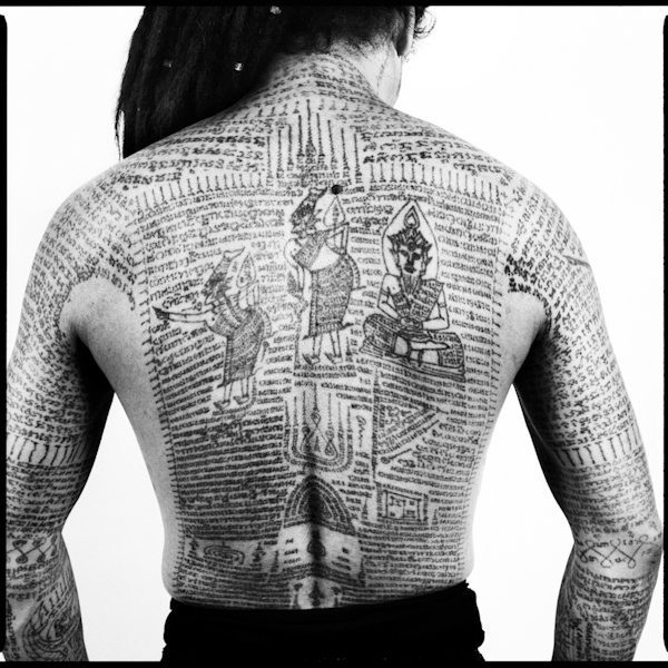 Details of tattoos on a tattoo master's back