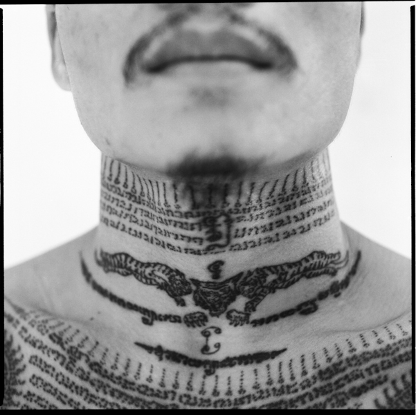 Tatoo details on a boxer's neck