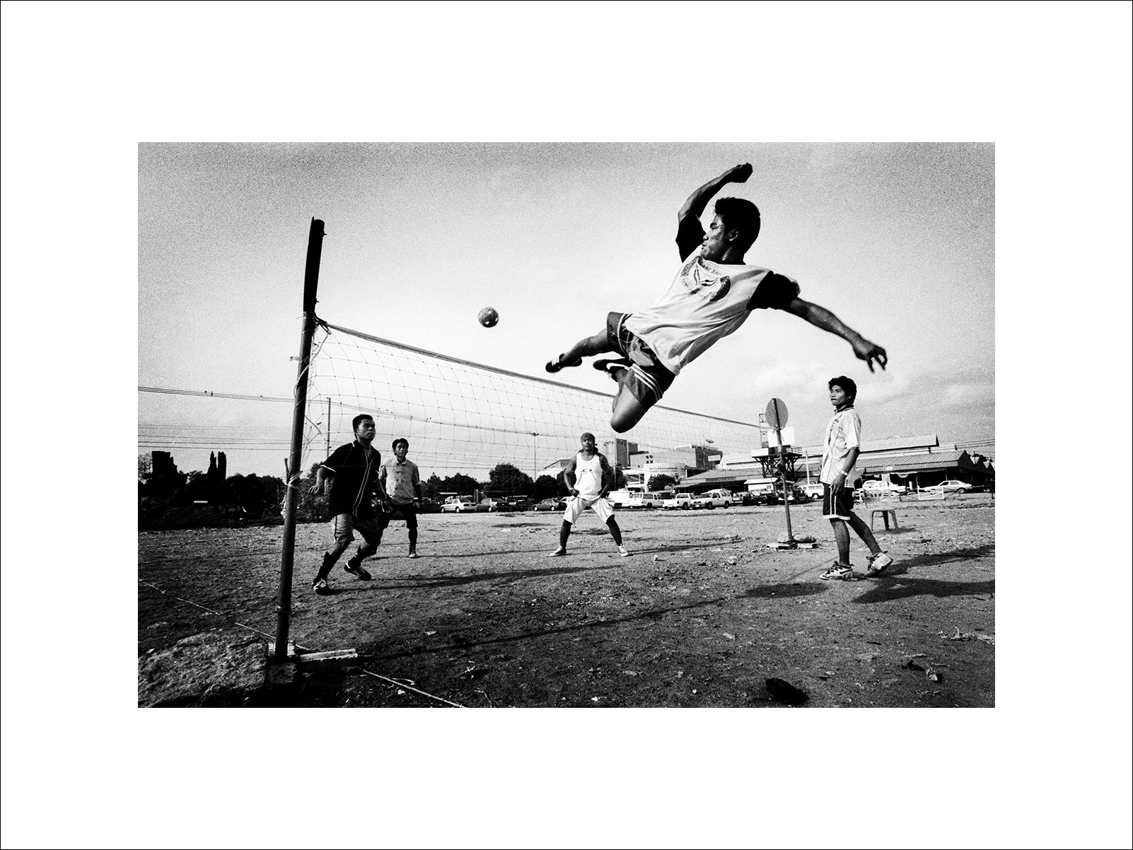 A Takraw player kicks the ball during a takraw game in Bangkok, Thailand